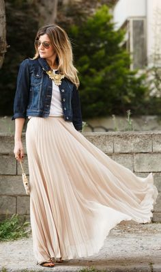 Dress up your denim with a feminine pleated maxi skirt.