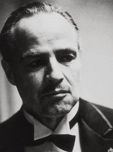 """The Godfather Fun Fact: Marlon Brando wanted to make Don Corleone """"look """"like a bulldog,"""" so he stuffed his cheeks with cotton wool for the audition. For actual filming, he wore a mouthpiece made by a dentist Godfather Tattoo, Mobsters Movie, The Godfather Wallpaper, Mafia Crime, Don Corleone, Mafia Gangster, Celebrities Then And Now, Portraits, Marlon Brando"""