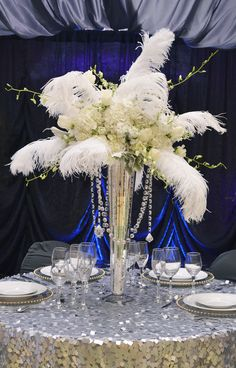 Great tablescape for The Great Gatsby! Feathers, flowers, metallics, uplighting and lots of bling! FestivitiesMN.com