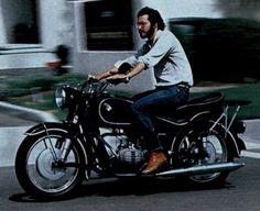 Steve Jobs riding a vintage BMW motorcycle