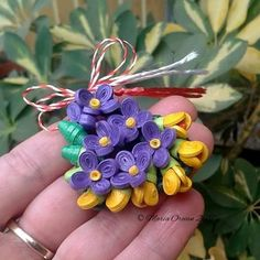 March brooche - fresias and violets by Maria Oroian Quilling Videos, Quilling Work, Quilling Flowers, Quilling Techniques, Paper Flowers, Paper Jewelry, Jewelry Art, Paper Art, Paper Crafts