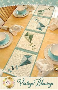 Vintage Blessings Table Runner Kit - July: Decorate your home all year long with a beautiful Vintage Blessings Table Runner by Jennifer Bosworth of Shabby Fabrics. This applique kit is for the July design. Table Runner measures approximately 12.5 x 53.