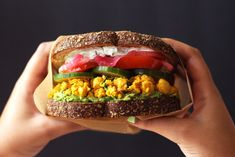 This vegan Mediterranean-style chickpea salad sandwich is colorful and bursting with flavor. Topped with a creamy and thick tzatziki.