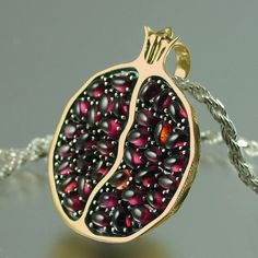 JUICY POMEGRANATE bronze and silver garnet pendant. $350.00, via Etsy.