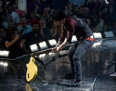 Billie Joe Armstrong smashes his guitar at the iHeartRadio Festival what a freakin' baby. Seriously grow up.
