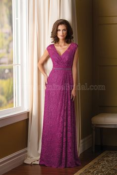 Jasmine Bridal Mother of the Bride/Groom Dress Jade Couture Style K178002 in Scarlet Purple. This beautiful lace dress is a stylish and chic special occasion gown. The classic silhouette of a V neckline and A-line skirt come together in this dress and accented by the beautiful lace and an intricate beaded sash detail.