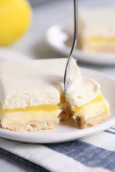 These lemon truffle shortbread bars are like diving head first into a pan of creamy, cheesecake-ish, lemon bar heaven. They are absolute perfection for lemon lovers! | melskitchencafe.com #lemon #lemonbars #lemoncheesecake #lemontruffle #shortbread