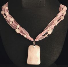 This Necklace is 21 inches in length and is made with a Faceted Pink Quartz Pendant with sterling silver bail, Pink Quartz Beads, Silver and clear white crystal Roundels strung on Pink Chiffon Ribbons