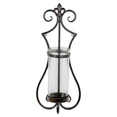 Scrolling iron wall sconce with a glass hurricane.Product: HurricaneConstruction Material: Iron and glassC...