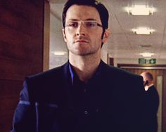 As Lucas North, in glasses. Somebody help me...