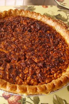 This English walnut pie is a quick and easy pie recipe! Bake the best walnut pie using walnuts and a premade pie crust. If you love pecan pie, you will love baking this walnut pie for a dinner party, Christmas, or Thanksgiving dessert!
