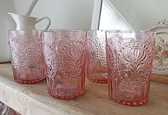 Use my pink glassware for flowers and candles. Use the other colors as serving dishes! :)