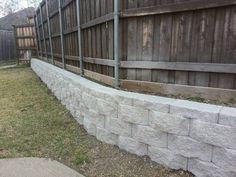 Dallas Retaining Wall by Longhorn Arbor and Fence