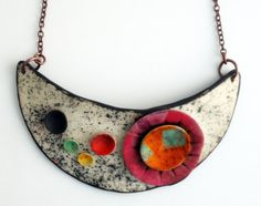 Polymer clay necklace.  - Unique organic shape.  - Length from top to bottom: 22 cm.  - The ring through which the T-bar is secured, is on the