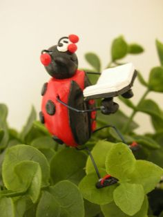 Cute ladybug garden stake! Comes from Small Idea on Etsy. Want to win a gift certificate to this amazing polymer clay shop? Enter here: http://pixelberrypiedesigns.blogspot.com/2012/04/giveaway-25-gift-certificate-small-idea.html