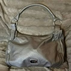 """Gorgeous Nine West Purse Gorgeous Nine West Purse With Silver Toned Accents - 18"""" w x 12"""" l, very little wear to outside (see last picture, can't see unless you're looking for it), there are some stains inside (see 3rd picture, which no one would see unless you opened it up & show it), other than that this Purse looks flawless to the naked eye & it's a great bag! Nine West Bags Shoulder Bags"""