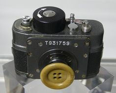 a stasi button hole spy camera
