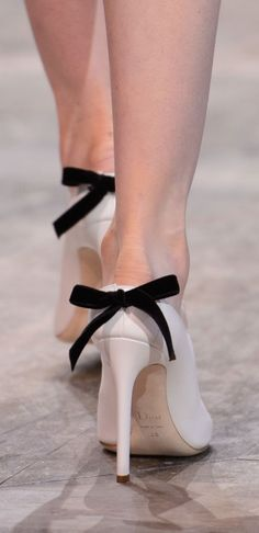 Christian Dior Spring 2016 - White stiletto pumps with black bows on the back #takeabow...x