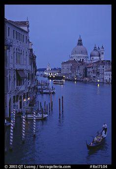 Gondola, Grand Canal, Santa Maria della Salute church from the Academy Bridge, dusk. Venice, Veneto, Italy