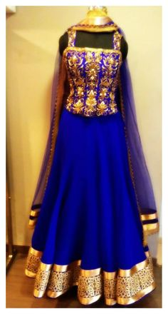 Bright blue lehenga with gold embroidery and a corset blouse. #bridal #indian #corset