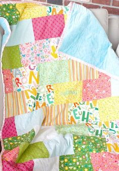 Snuggle Bricks Baby Quilt - Grab some baby-themed fat quarters and an afternoon of your time to quickly learn how to make a baby quilt pattern that is as cuddly as it is easy. The Snuggle Bricks Baby Quilt pieces together 12 fat quarters and 2 yards of snuggle fabric to make a oh so simple brick design that will match just about any nursery.