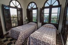 At the top of the tower in La Casa Grande.  360 degree views around the countryside. Twin beds only.  Accessed through Room Nine beneath it.