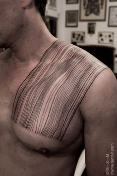 Wood grain or bar code? can't decide if I like or not.....but maybe if it were smaller and on the back of my shoulder?