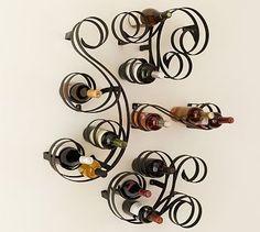 wall art in the shape of a wine rack, cool.  Swirl Wine Racks #potterybarn