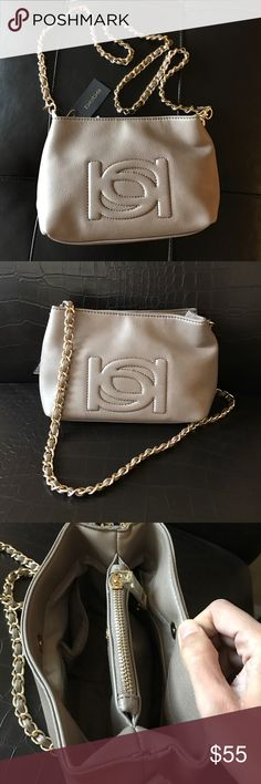 Bebe taupe crossbody bag Cute crossbody with link strap . Top center has zip compartment and 2 snap closure compartments. bebe Bags Crossbody Bags