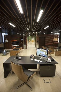 Sleek, sophisticated and modern law office with lots of classic Eames chairs, designed by Nino Virag, Zagreb, Croatia.