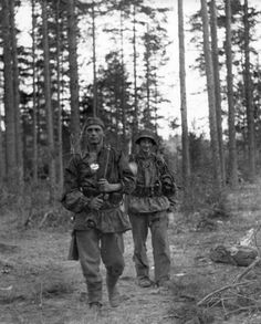 """Two riflemen of the Police Division on patrol in the forests surrounding Leningrad, Sept 12, 1941. The Police Division was Himmler's contribution to the army in his effort to validate the role of the SS as regular troops. Policemen were hardly trained troops and the division didn't fare well in its early days. Eventually, the division became """"SS Police Division"""" with Waffen SS training."""