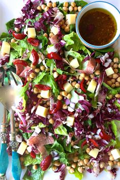 This Antipasti Chopped Salad recipe is a delicious side or main dish, perfect for a potluck, luncheon, or game day party!