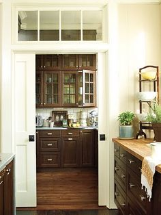 Butler's pantry, scullery, whatever you call it, I want one and I want it stacked with vintage china and crystal.