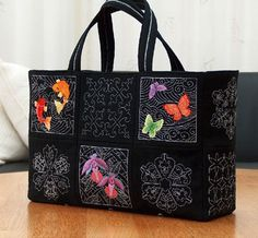 A tote bag embroidered with fish and butterflies from the Japanese Sashiko Designs.