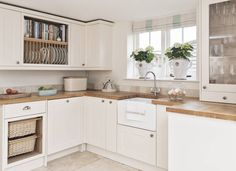 Classic country kitchen with wooden worktops, shelves and sink. Shaker Kitchen Cabinets, Kitchen Cabinet Styles, Painting Kitchen Cabinets, Kitchen Paint, Oak Cabinets, Kitchen Tile, Small Kitchen Diner, New Kitchen, Kitchen Ideas