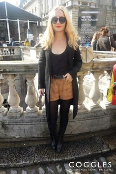 #lfw streetstyle with soft-touch camel shorts, black heeled boots and a loose fit vest. | See #coggles #streetstyle http://www.coggles.com/life/street-style.list?fullsite&affil=thgsocial #fashion #style #clothes #womenswear