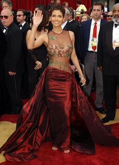 First Up: Halle Berry, in of course, her iconic 2002 dress from Elie Saab. Description from cinderellasgowns.blogspot.com. I searched for this on bing.com/images