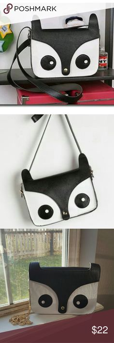 Modcloth Critter Me Timbers Owl Bag Youre awe about statement-making accessories, and this wildly stylish owl bag offers plenty to talk - or hoot - about! In black and white vegan faux leather, this quirky crossbody lends an adorable wow factor to any look.  Comes with two straps - a black faux leather strap and a gold chain strap I added for a little pizazz. :) Brand new without tags! ModCloth Bags Crossbody Bags