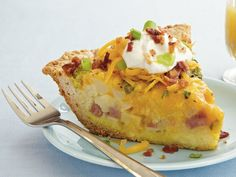 All the savory goodness of a baked potato in breakfast form! An easy Bisquick crust is topped with frozen hash browns, Cheddar cheese, ham, eggs and green onion. Bacon and sour cream make it absolutely irresistible. One of Betty's most popular quiche recipes!
