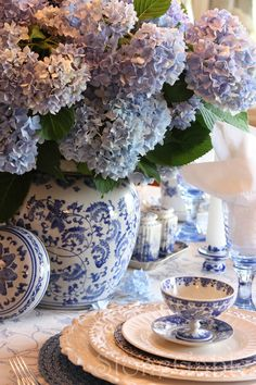 Blue hydrangeas and blue porcelain table setting.. So beautiful