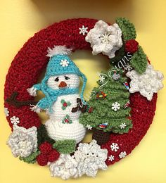 This fun Winter Wreath looks great on a door or wall all Winter long. Make one for a gift, or make extra snowmen and trees to use as ornaments, stocking stuffers or package toppers.