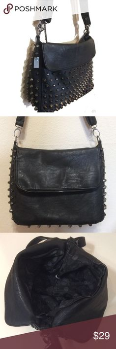 🆕 Stylish vegan leather medium bag Never used this bag with a cool attitude! Vegan leather and studs, has detachable long strap for crossbody, shoulder strap and a grey chain,, it is missing a decorative piece underneath, got anyway as I think it looks best using the plain lid side with the studded as opposed to studded and studded, not visible if used like this, if you want a bag with a bit of punk 😍Never wore, still has one of the manufacturers tags attached, skull print lining…