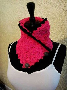 hot pink cowl with black edging and a great button detail