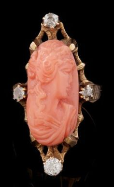 AN ANTIQUE CORAL CAMEO AND DIAMOND RING