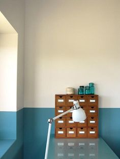 LOVE this half-painted wall- punch of color with the brightness of white walls. Also- love this specific blue in the photo with the honey-oak card catalog- similar to the new house's woodwork.