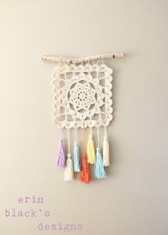 Stick, granny square and tassel wall decoration