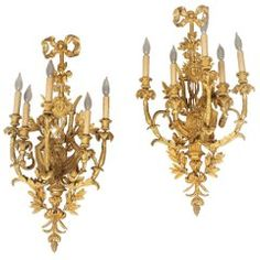 A large and elaborate pair of early century gilt bronze five-light sconces Each backplate shaped as a lyre, centered with a mask of Apollo, the top with a bow knotted ribbon, the arms and base decorated with leaves and berries. Brass Mirror, Brass Sconce, Wall Sconce Lighting, Wall Sconces, Wall Lights, Ceiling Lights, Bronze, Scroll Design, Polished Brass