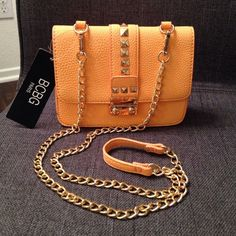BCBG Paris Crossbody Bag BCBG Paris crossbody bag - removable chain strap so it could be used as a clutch. New with tags - never been used! Fun bright orange color for spring/summer! Measures about 7in across and 5.5in long. BCBG Bags Crossbody Bags