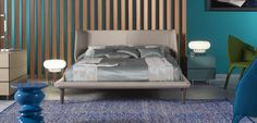 Structure in solid wood, plywood and particle board. Headboard in fireproof HR foam 30kg/m3. Frame in HR foam 75kg/m3, upholstered in leather or fabric, tone on tone or contrasting piping. Legs in stained solid oak.    Presented mattress 160 x 200 cm.