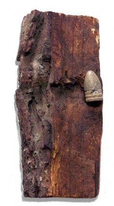 Roughly 8 inch long chunk of wood from the Gettysburg Battlefield which has a minie ball embedded within it. MichToy Collection.